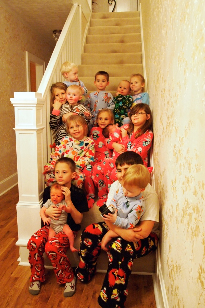 Great grandkids at the lake - traditional stair picture.  I remember all the grandkids sitting on this step.  I started sitting here with Ben fourteen years ago.  It's nice to now see the great grandkids take their turn.