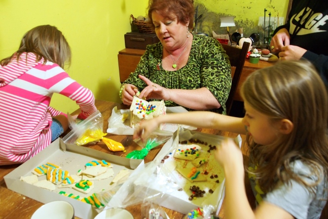 Decorating gluten free christmas cookies and house with grandma.