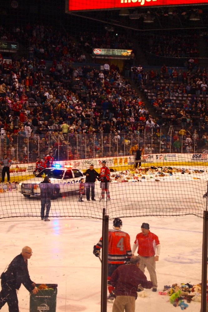 The Cincinnati Police then drove their cruiser onto the ice and collected up the bears to give to needy kids.