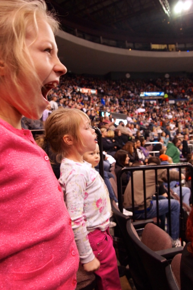 Trying to yell loud enough ti get a free t-shirt.  I apologize to the people that were in front of us.  There is nothing quite like a shrill, air piercing scream of little girls.