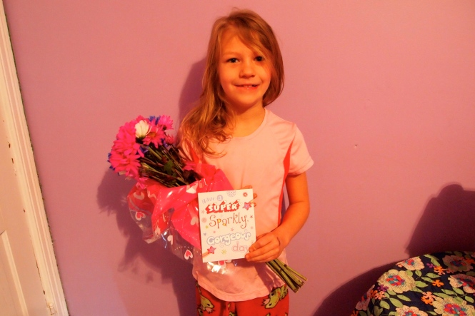 We woke her up with cards and flowers.