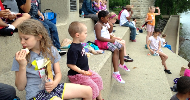 Blackburn and Isabella having lunch on the serpentine wall during her field trip.