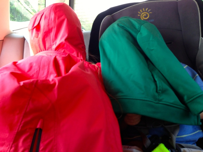 Blackburn and Vita cover their heads with their jackets so they can play their iPods without the glare of the sun.  I love the confused looks on cars as they pass us by.