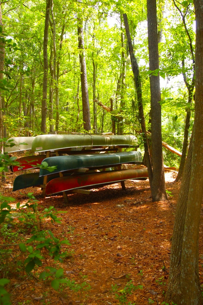 Stack of canoes - marked for employee use only, love the different colors.