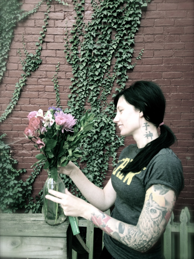 Ben gave me flowers, here I was trying to arrange them without laughing.