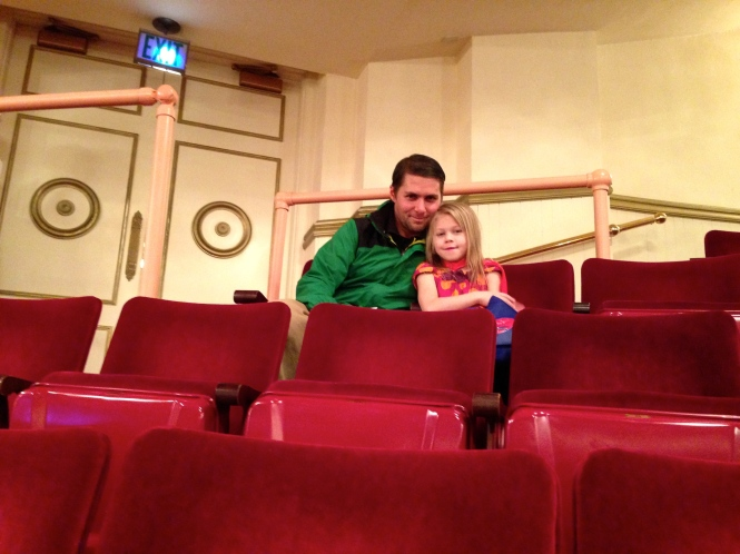 When we purchased seats in our school's section we had to get three in one row and two seats in another row.  Vita sat with daddy.