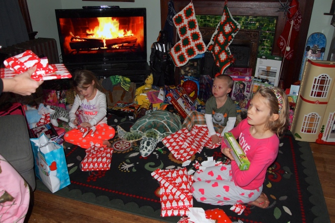 The big gifts for them this year were, remote control truck, Barbie dream house and a polaroid camera.   Yes, we are that family that has the Netflix fake fireplace playing in the background.